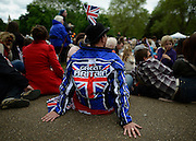 """© Licensed to London News Pictures. 05/06/2012. London, UK. A man wears a jacket saying 'Great Britain"""" to watch the Jubilee Procession on the Mall today 5th June 2012.  The Royal Jubilee celebrations. Great Britain is celebrating the 60th  anniversary of the countries Monarch HRH Queen Elizabeth II accession to the throne this weekend Photo credit : Stephen Simpson/LNP"""