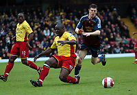 Photo: Tony Oudot.<br /> Watford v Newcastle United. The Barclays Premiership. 13/05/2007.<br /> Dan Shittu of Watford tackles James Milner of Newcastle