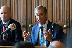 © Licensed to London News Pictures. 12/07/2018. London, UK.  Nigel Farage, former UKIP leader speaking in support of Donald Trump's visit to London at a Bow Group event held in the Palace of Westminster. A bust of Donald Trump was seen sat on the table in front of Nigel Farage. Photo credit: Vickie Flores/LNP