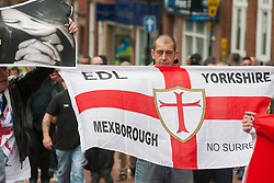 """Rotherham England<br /> 13 September 2014 <br /> Local EDL supporter from Mexbrough in Yorkshire aproaches Rotherham Town Hall before the start of the English Defence Leagues Justice for the Rotherham 1400 March on Saturday Afternoon described by an EDL Facebook Page as """"a protest against the Pakistani Muslim grooming gangs"""" on Saturday Afternoon <br /> <br /> <br /> Image © Paul David Drabble <br /> www.pauldaviddrabble.co.uk"""