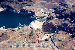 Aerial of Colorado River and Hoover Dam on border of Arizona, AZ, Nevada, NV, water source, flood control, landscape, engineering feat, image nv438-18736.Photo copyright: Lee Foster, www.fostertravel.com, lee@fostertravel.com, 510-549-2202