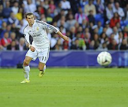 Real Madrid's Gareth Bale chases a loose ball - Photo mandatory by-line: Joe Meredith/JMP - Mobile: 07966 386802 12/08/2014 - SPORT - FOOTBALL - Cardiff - Cardiff City Stadium - Real Madrid v Sevilla - UEFA Super Cup
