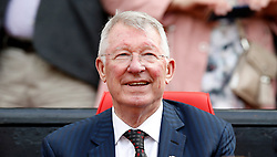 Manchester United Legends manager Sir Alex Ferguson in the dugout during the legends match at Old Trafford, Manchester.