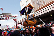 A mikoshi or portable shrine featuring a large iron phallus is carried during the Kanamara matsuri or festival of the iron phallus in Kawasaki Daishi near Tokyo, Japan. Sunday April 1st 2012