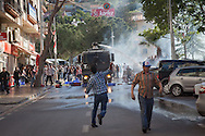 Demonstrators and mourners in the town of Soma, western Turkey throw stones at police water canon trucks, as police used both water and tear gas to disperse crowd, unprovoked.