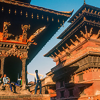 A family rests at a temple in Patan, Nepal, a sister city to Kathmandu. 1986