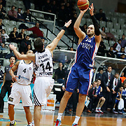 Anadolu Efes's Nenad Krstic (R) during their Turkish basketball league match Besiktas integral Forex between Anadolu Efes at BJK Akatlar Arena in Istanbul, Turkey, Monday, January 05, 2015. Photo by TURKPIX