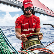 Leg 6 to Auckland, day 18 on board MAPFRE, Louis Sinclair trimming. 24 February, 2018.