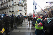 December, 8th, 2018 - Paris, Ile-de-France, France: Demonstrator arguing with riot police on Champs Elysees. The French 'Gilets Jaunes' demonstrate a fourth day. Their movement was born against French President Macron's high fuel increases. They have been joined en mass by students and trade unionists unhappy with Macron's policies. Nigel Dickinson