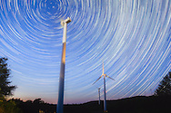 A series of stacked long exposures show the rotation of the earth around its northern polar axis, the wind turbines near Thomas, West Virginia making up the foreground.