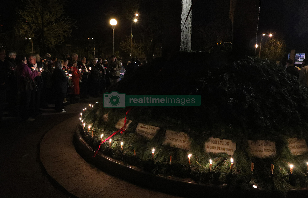 April 26, 2018 - Kyiv, Ukraine - Candles burn at the To the Heroes of Chornobyl memorial kurgan during a commemorative prayer service for the victims of the Chornobyl accident 32 years after the tragedy, Kyiv, capital of Ukraine, April 26, 2018. Ukrinform...KYIV. People have gathered at the To the Heroes of Chornobyl memorial kurgan at midnight to pay tribute to those who died as a result of the Chornobyl (Chernobyl) disaster. The accident at the fourth reactor of the Chornobyl Nuclear Power Plant took place 32 years ago at night on April 26, 1986. (Credit Image: © Danil Shamkin/Ukrinform via ZUMA Wire)