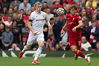 Football - 2021 / 2022 Premier League - Liverpool vs Burnley - Anfield - Saturday 21st August 2021<br /> <br /> <br /> <br /> Liverpool's Kostas Tsimikas under pressure from Burnley's Chris wood