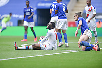 LEICESTER, ENGLAND - JULY 04: Christian Benteke of Crystal Palace goes down in pain after a challenge from Ryan Bennett of Leicester City during the Premier League match between Leicester City and Crystal Palace at The King Power Stadium on July 4, 2020 in Leicester, United Kingdom. Football Stadiums around Europe remain empty due to the Coronavirus Pandemic as Government social distancing laws prohibit fans inside venues resulting in all fixtures being played behind closed doors. (Photo by MB Media)