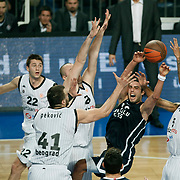 Anadolu Efes's Sasha VUJACIC (2ndL) during their Turkish Airlines Euroleague Basketball Group C Game 6 match Anadolu Efes between Partizan at Sinan Erdem Arena in Istanbul, Turkey, Wednesday, November 23, 2011. Photo by TURKPIX