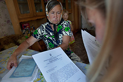 Vita Kalembet, a paralegal, visits Nadia Yarekha whose daughter was murdered in a domestic violence dispute, Poltava, Ukraine, June 18, 2011. Yarekha went to Kalembet looking for guidance on how to legally adopt her granddaughter, Anastasia Yarekha, 6. More than half of the worldÕs population, four billion people live outside the rule of law, with no effective title to property, access to courts or redress for official abuse. The Open Society Justice Initiative is involved in building capacity and developing pilot programs through the use of community-based advocates and paralegals in Sierra Leone, Ukraine and Indonesia. The pilot programs, which combine education with grassroots tools to provide concrete solutions to instances of injustice, help give poor people some measure of control over their lives.