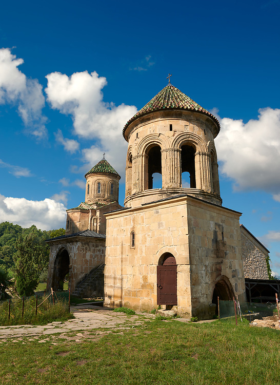 Pictures & images of Gelati Georgian Orthodox churches bell tower with  St Nicholas church, 13th century, behind. The medieval Gelati monastic complex near Kutaisi in the Imereti region of western Georgia (country). A UNESCO World Heritage Site. .<br /> <br /> Visit our MEDIEVAL PHOTO COLLECTIONS for more   photos  to download or buy as prints https://funkystock.photoshelter.com/gallery-collection/Medieval-Middle-Ages-Historic-Places-Arcaeological-Sites-Pictures-Images-of/C0000B5ZA54_WD0s<br /> <br /> Visit our REPUBLIC of GEORGIA HISTORIC PLACES PHOTO COLLECTIONS for more photos to browse, download or buy as wall art prints https://funkystock.photoshelter.com/gallery-collection/Pictures-Images-of-Georgia-Country-Historic-Landmark-Places-Museum-Antiquities/C0000c1oD9eVkh9c