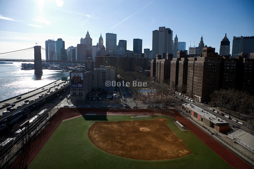 view of down town Manhattan with baseball filed in foreground