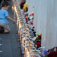 """A young visitor to the pauses along the """"Wall of Names"""" at the Flight 93 National Memorial on the eve of the 12th Anniversary of the crash of Flight 93 near Shanksville,  Pennsylvania on September 10, 2013.  UPI/Archie Carpenter"""