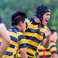 Joshua Tan (#4) of Anglo-Chinese School (Independent) reacts after his team scored a try against St. Andrew's Junior College in the final of the National 'A' Division Rugby Championship at the Home Team Academy on May 14, 2014, in Singapore.