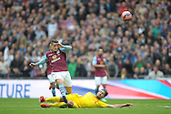 Ashley Westwood of Aston Villa has a shot blocked by Emre Can of Liverpool. The FA Cup, semi final match, Aston Villa v Liverpool at Wembley Stadium in London on Sunday 19th April 2015.<br /> pic by John Patrick Fletcher, Andrew Orchard sports photography.