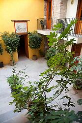 North America, Mexico, Guanajuato State, Guanajuato,  hotel courtyard wtih plants and iron balconies. The historic city of Guanajuato is a UNESCO World Heritage Site.  PR
