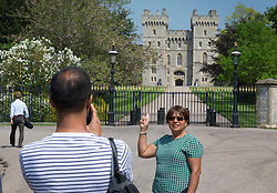 © Licensed to London News Pictures. 08/05/2018. Windsor, UK. Tourists take photographs on The Long Walk at Windsor Castle ahead of the Royal Wedding of Prince Harry and Meghan Markle. With 12 days to go there is lots of activity in and around the grounds of Windsor Castle. Photo credit: Peter Macdiarmid/LNP
