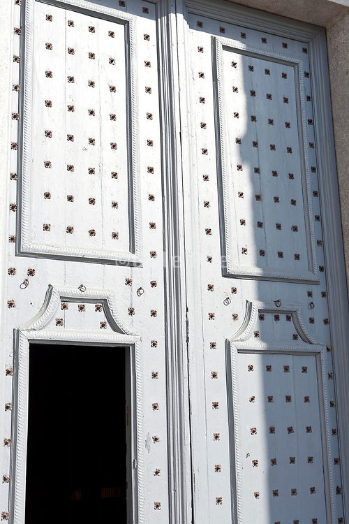 close up of the large old wooden doors of a church, Basilica de Sant Feliu in Girona Spain