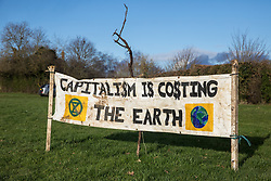 Harefield, UK. 17 January, 2020. A banner erected by activists from Stop HS2 and Extinction Rebellion who are beginning a three-day 'Stand for the Trees' protest in the Colne Valley. The event has been timed to coincide with tree felling work by HS2 adjacent to the site of Stop HS2's Colne Valley wildlife protection camp. Bailiffs acting for HS2 have been evicting Stop HS2 activists from the camp for the past week and a half. 108 ancient woodlands are set to be destroyed by the high-speed rail link.