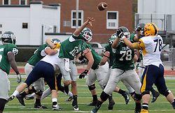 18 October 2014:  squeezed tight, Donovan Laible gets off a pass during an NCAA division 3 football game between the Augustana Vikings and the Illinois Wesleyan Titans in Tucci Stadium on Wilder Field, Bloomington IL