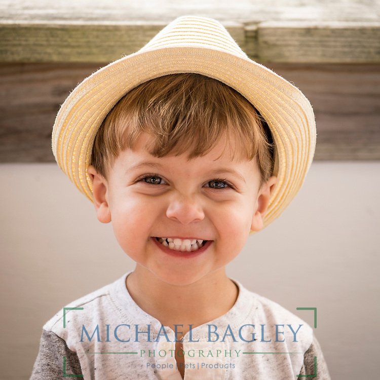 Henry, a young man wearing a hat, by Connecticut portrait photographer Michael Bagley.