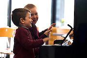 21/9/2011. News. New Ross Piano Festival. Junior infants from St Canices N.S. Rosbercon,  New Ross, Co Wexford get some practice in at the piano placed at the Dunbrody Visitors Centre, New Ross, From left, Jamie Connolly-Smith and Jack Allen all aged 4yrs. The 'PLAYME' Pianos are dotted around the town for the New Ross Piano Festival weekend - For a full programme see newrosspianofestival.com or visitwexford.ie - Photograph Patrick Browne<br /> <br /> For immediate release<br /> <br /> World Renowned Pianists Descend on New Ross for Sixth Annual Piano Festival<br /> September 22 to 25<br /> <br /> Eight internationally known pianists will descend upon the riverside town of New Ross this weekend for the sixth annual Piano Festival. The famous pianists will share the ivory keys with some budding musicians as ten pianos are dotted around the town in obscure locations such as the local supermarkets and the town hall for 'PLAYME' time at the festival.<br /> <br /> Visitors to the New Ross Piano Festival can expect double the fun as a spectacular two-piano weekend of classical concerts takes place for the first time from September 22 to 25. Critically acclaimed pianists Katya Apekisheva, Norikeo Ogawa, Kathryn Stott, Charles Owen, Igor Roma Finghin Collins, Fiachra Garvey, and Enrico Pace will all perform at the sixth festival in a spectacular two-piano weekend.<br /> Festival goers are in for a treat as the festival is hosting a day of concerts aimed at children and families, of 'Carnival of the Animals' on Friday, September 23 to celebrate 'National Culture Night'. Daytime performances for schoolchildren of Saint-Saens' 'Carnival of the Animals', supported by the National Concert Hall and narrated by actor Barry McGovern, as well as a free 6.30pm 'Opening Fanfare Concert' for everyone in association with Culture Night, featuring Rossini's 'William Tell' Overture and another performance of Carnival of the Animals [tickets necessary]. And on Friday and Saturday lunchtimes