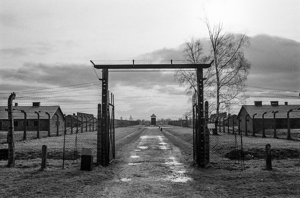 A gate and  barbed wire fence at the Auschwitz (Birkenau) Nazi concentration camp. It is estimated that between 1.1 and 1.5 million Jews, Poles, Roma and others were killed here in the Holocaust between 1940-1945.