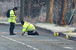 © Licensed to London News Pictures . 02/12/2012 . Bury , UK . Police investigate at the scene of a fatal road traffic accident on Bury Road , Radcliffe . Police report the car , a silver VW Polo , overturned and collided with a tree after it was observed driving at excess speed along Bury Road . A police car with its emergency equipment activated was in pursuit at the time . The driver and a passenger died at the scene . The road is closed . Photo credit : Joel Goodman/LNP