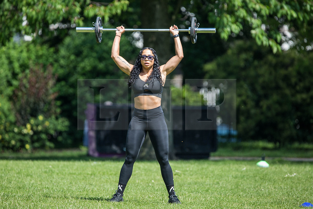 © Licensed to London News Pictures. 05/06/2021. London, UK. A woman exercises in Victoria Park, east London; on a sunny day. Photo credit: Marcin Nowak/LNP