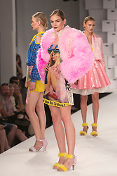 © Licensed to London News Pictures. 01/06/2014. London, England. Collection by Charlotte Lewis from the Manchester School of Art. Graduate Fashion Week 2014, Runway Show at the Old Truman Brewery in London, United Kingdom. Photo credit: Bettina Strenske/LNP