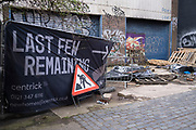 Last few remaining flats for sale sign beside a derelict building in Digbeth on 14th March 2020 in Birmingham, United Kingdom. Despite central Birmingham undergoing a huge redevelopment, delapidated buildings still sit alongside new apartment blocks.