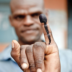 Dar Es Salaam, 31 October 2010.A Tanzanian citizen shows his ink marked finger after voting..The European Union has launched an Election Observation Mission in Tanzania to monitor the general elections, responding to the Tanzanian government invitation to send observers for all aspects of the electoral process..The EU sent this observation mission led by Chief Observer David Martin, a member of the European Parliament. .PHOTO: Ezequiel Scagnetti / European Union