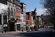 A look down a virtually empty Northampton Street in Easton, Pennsylvania on Mar. 21, 2020, as communities across the Lehigh Valley are adjusting to life during the coronavirus pandemic that is impacting the daily lives of residents both socially and economically. (Photo by Matt Smith)