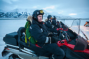 UNIS student Skafti Brynjólfsson relaxes in his snowmobile in Adventdalen on a class field trip to Scott Turnerbreen, Svalbard.