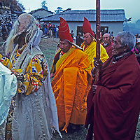A costumed actor and Tibetan Buddhist lamas lead a procession as part of the annual Mani Rimdu festival held at Nepal's Tengboche Monastery.  (Photo taken in 1980.) The high lama is second from left.