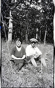 young adult couple sitting at edge of woods Missouri USA 1920s