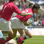 24/05/2002<br /> Sport - Rugby Union<br /> IRB World Sevens Series - Twickenham<br /> Wales V Argentina<br /> Mike Phillips, breaks through the defense to set up a welsh move.<br />    [Mandatory Credit, Peter Spurier/ Intersport Images]<br />    [Mandatory Credit, Peter Spurier/ Intersport Images]