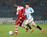 Middlesbrough's Albert Adomah vies for possession with Huddersfield Town's Oliver Norwood<br /> <br /> Photo by Rich Linley/CameraSport<br /> <br /> Football - The Football League Sky Bet Championship - Huddersfield Town v Middlesbrough - Tuesday 25th March 2014 - The John Smith's Stadium - Huddersfield<br /> <br /> © CameraSport - 43 Linden Ave. Countesthorpe. Leicester. England. LE8 5PG - Tel: +44 (0) 116 277 4147 - admin@camerasport.com - www.camerasport.com