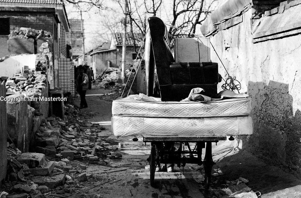 Furniture removals in a demolished hutong in Beijing