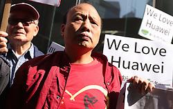 December 18, 2018 - Hong Kong, CHINA - Pro-China demonstrators gather downstair of Canadian Consulate General in Central, calling for immediate releasing of Meng Wanzhou.Dec-18,2018 Hong Kong.ZUMA/Liau Chung-ren (Credit Image: © Liau Chung-ren/ZUMA Wire)