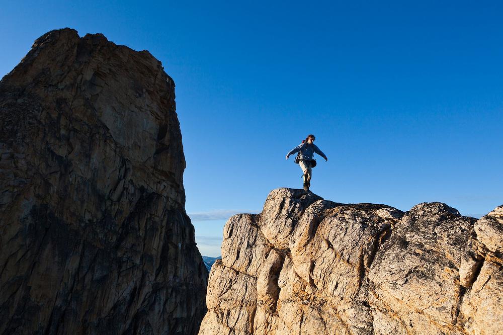 Kevin Steffa walks on a narrow ridge across from the East Face of Golden Horn, Okanogan National Forest, Washington.