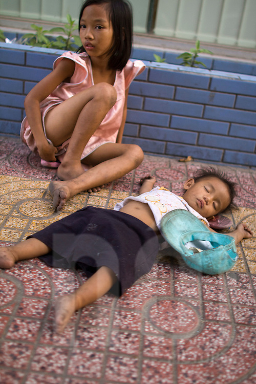 Two young homeless kids in a street of Ho Chi Minh City Saigon Vietnam