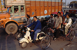 Scooters; bicycle rickshaw and lorry stuck in traffic at Patiala; Punjab; India,