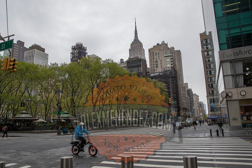 A motorist rides on a virtually empty street due to the Coronavirus (Covid-19) outbreak in New York City, New York on Friday, May 8, 2020.  (Alex Menendez via AP)
