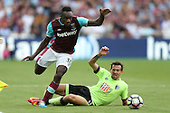 Michail Antonio of West Ham United goes past Charlie Daniels of AFC Bournemouth. Premier league match, West Ham Utd v AFC Bournemouth at the London Stadium, Queen Elizabeth Olympic Park in London on Sunday 21st August 2016.<br /> pic by John Patrick Fletcher, Andrew Orchard sports photography.